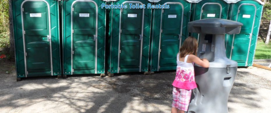 Portable Toilet Rentals; girl standing next to portable toilets